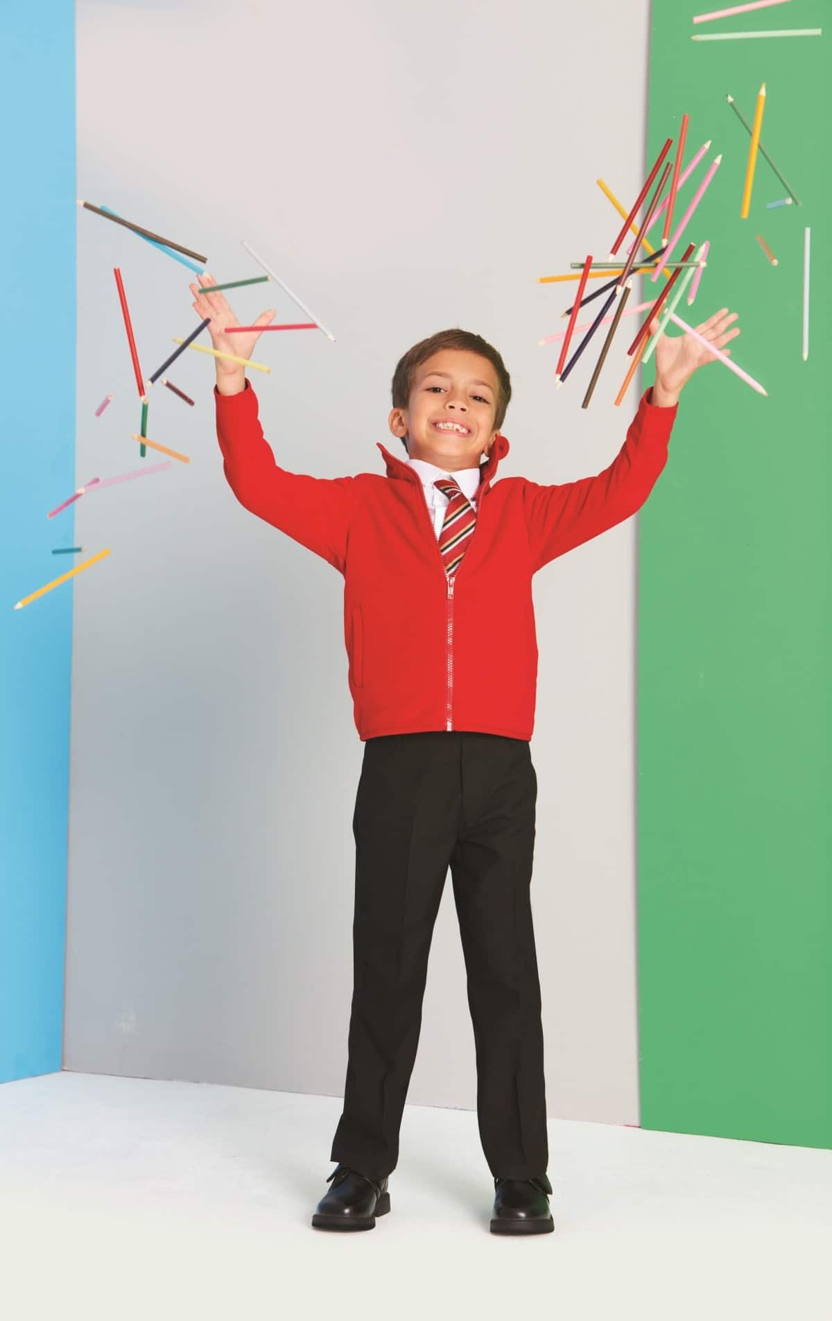 School kid throwing pencils in the air